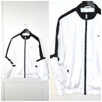 90s NIKE windbreaker / vintage early 1990s CLUB KID black + white athletic jacket os