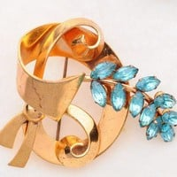 Gold tone bow/ribbon designed brooch with aqua rhinestones | VintageAnelia - Jewelry on ArtFire