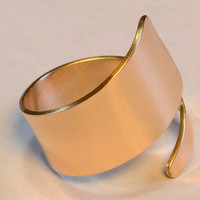 Bronze Bypass Ring Wrapping Sleek Modern Styling and Casting Golden Shine