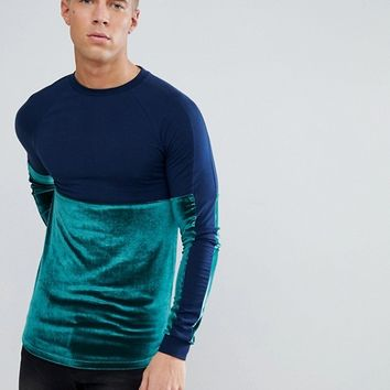ASOS Longline Muscle Long Sleeve T-Shirt With Velour And Jersey Panelling In Navy at asos.com
