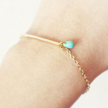 gold bar minimalist bracelet  with a pop of turquoise by PetiteCo
