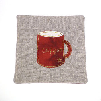 Handmade fabric coaster for your cuppa. Embroidered coaster with mug design. Natural linen, chestnut brown fabric, gold coloured stitching.