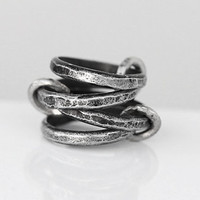 Four linked band rings. Distressed and hammered. Hand forged.