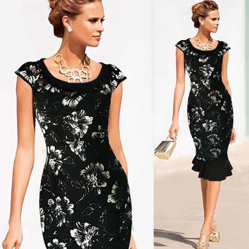 Flattering Black Dress With Floral Print, Peter Pan Collar, And Chic Capped Sleeves