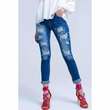 Skinny worn jeans and pearl detail