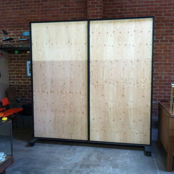 wrought iron and wood room divider