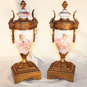 Pair of Bronze and Porcelain Urns