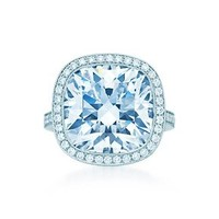 Tiffany & Co. -  Cushion-cut diamond ring in platinum with round brilliant diamonds.