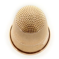 A victorian rose gold thimble - Bentley & Skinner