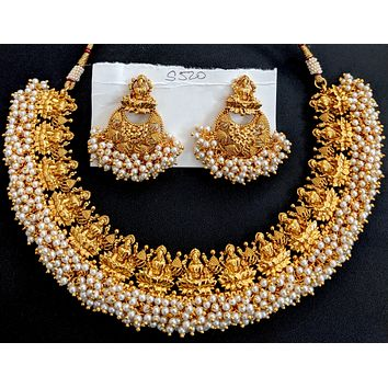 Goddess Lakshmi gold imitation with pearl cluster bead surrounding choker necklace and earring set