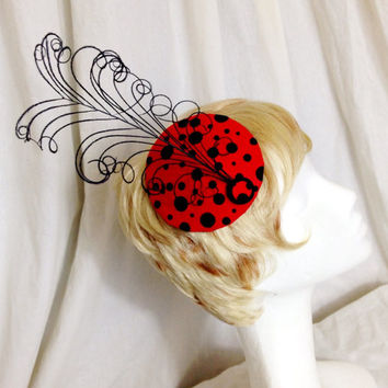 Ladybug felt and curled feather derby cocktail hat