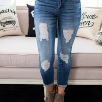 Holding Back Distressed Skinny KanCan Jeans