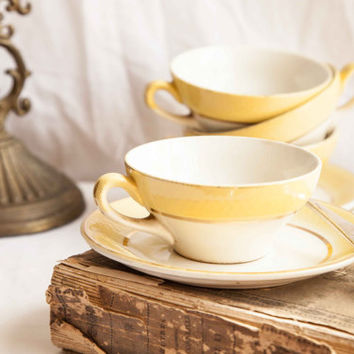Vintage french tea or coffee cups with saucers