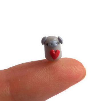 Micro polymer clay pig sculpture, miniature pig terrarium figurine, tiny purple pig figure, micro animal figurine, clay animal sculpture.