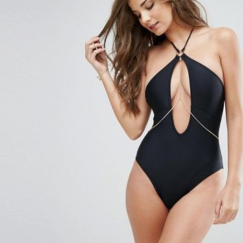 Lost Ink Chain Cut Out Swimsuit at asos.com