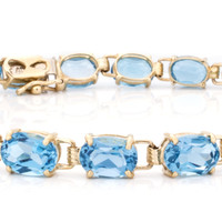 Blue Topaz Gold Tennis Bracelet