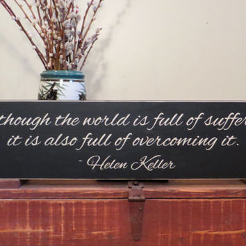 Although the world is full of suffering, it is also full of overcoming it wood sign