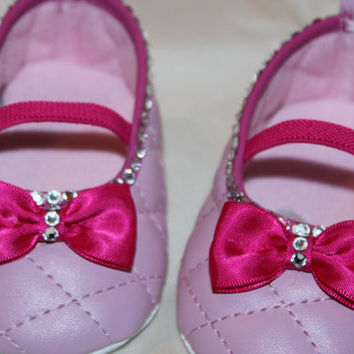Light pink baby girl shoes with hot pink trim and bow and beautiful Swarovski Crystals