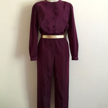 Vintage 1970s 'Mr K' plum coloured long sleeved taffeta jumpsuit with buttons and bib front