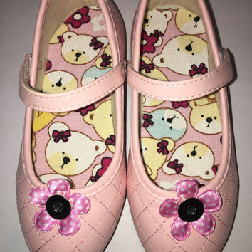 Pink SASSAFLATS custom shoes have a snap to attach magnetic snap on shoe bows/ hair bows they are available in toddler and young girl sizes