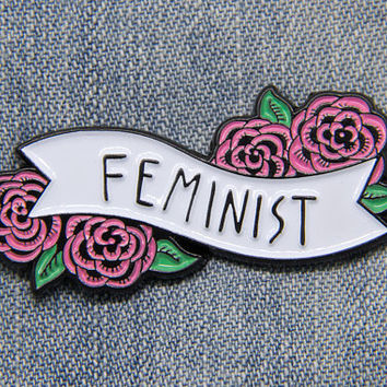 Feminist enamel pin of a black and white banner with pink flowers - Cute empowering feminism quote pin for women - Cool gift pins