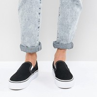Vans Platform Slip On Trainers In Black And White at asos.com