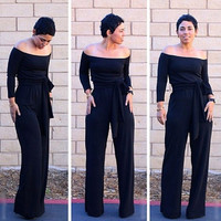 Black Off Shoulder Long Sleeve Flared Leg Jumpsuit
