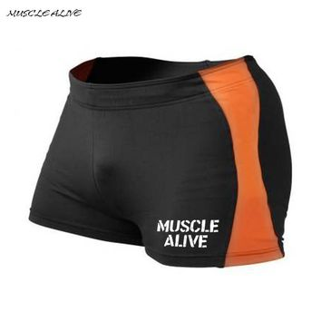 "Men Bodybuilding Shorts Fitness Spandex Workout 4"" Inseam Gyms Compression Male Sexy Skinny Elastic Waist Print Black Orange"