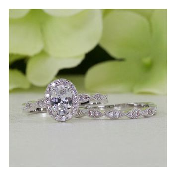 1.00 ct. Sterling Silver Halo Art Deco Style Oval CZ Engagement Ring Set