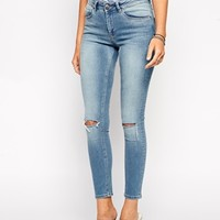 ASOS Mid Rise Skinny Jeans in Brooklyn Light Wash Blue with Ripped Knees