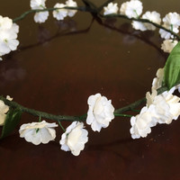 Floral crown with small white flowers for festivals or summer outfits