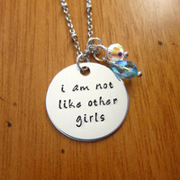 "Disney's ""Alice in Wonderland"" Inspired Necklace. ""I am not like other girls"". Silver colored. Swarovski crystals."