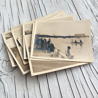 English 1920s scenes: seaside, strolling on the promenade, cricket, boating, 12 original silver sepia vintage photographic prints.