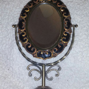 Vintage Swivel Vanity Mirror Made of Metal With Rhinestones and Maroon, Black. Gold Enamel Ornate Design