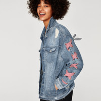 DENIM JACKET WITH BOWSDETAILS