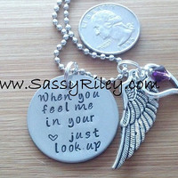 Just look up disc handstamped necklace
