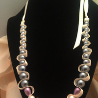 Glass pearl beaded necklace.  Purple and dark grey beads and cream ribbon.
