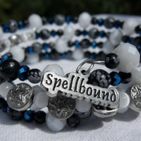 memory wire wrap bracelet - snowflake obsidian star bead with white and blue crystal and cats eye glass spellbound charm