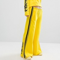 Ellesse Wide Leg Trousers With Contrast Satin Side Stripe at asos.com