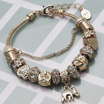 Gold Layered Women Elephant Fancy Bracelet, with White Crystal, by Folks Jewelry