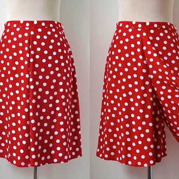 The JB Bloomers Polka Dot Bootie Short is made of 80% polyester and 20% spandex. It is a lo-rise short with a v-notch waistband. Comes in adult and youth sizes.
