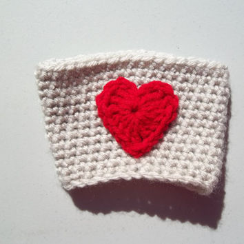 White coffee sleeve with a red heart