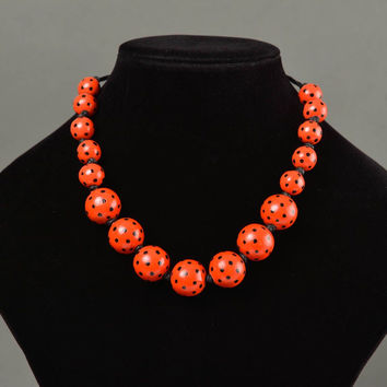 Handmade designer necklace with red painted wooden large beads on waxed cord