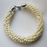 White Kumihimo Bracelet with beads, Beaded pearly white Kumihimo jewelry, White pearl kumihimo bracelet, White Magatama Bead bracelet