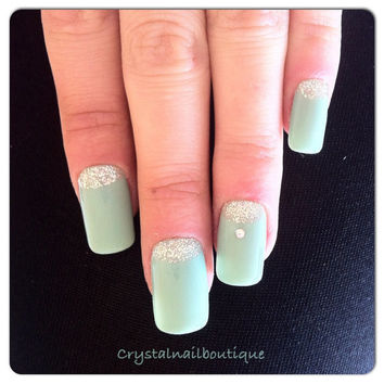Mint/teal with glitter moon nails
