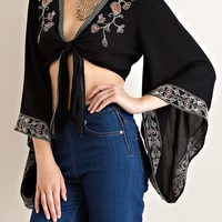 This gorgeous crop top features floral patterned embroidered (Embroidery Coloring: olive green, red and white) on soft gauze fabrication, kimono long sleeves with floral pattern embroidered design, crop style construction, open front with self-tie closure.