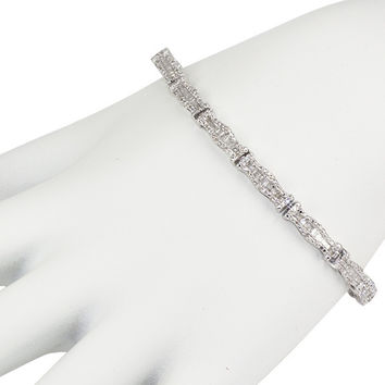 Gorgeous 14K White Gold And Diamond Bracelet. This Bracelet Features Squiggle Shape Links With Banquettes And Round Small Diamonds. There Is Total Of .49 Ct Of Banquettes And .99 Ct Small Round Diamonds.