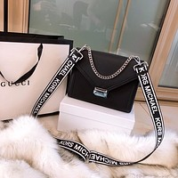 MK Black-and-white spelling letter wide shoulder strap oblique Bag