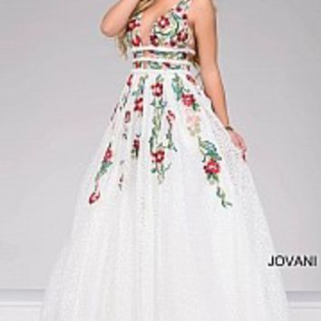 Ivory and multi long sleeveless v-neckline dress with floral embroidery.