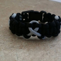 Survivors Series Brain Cancer Awareness Paracord Bracelet. Show your support with this Brain Cancer Awareness Paracord Bracelet.